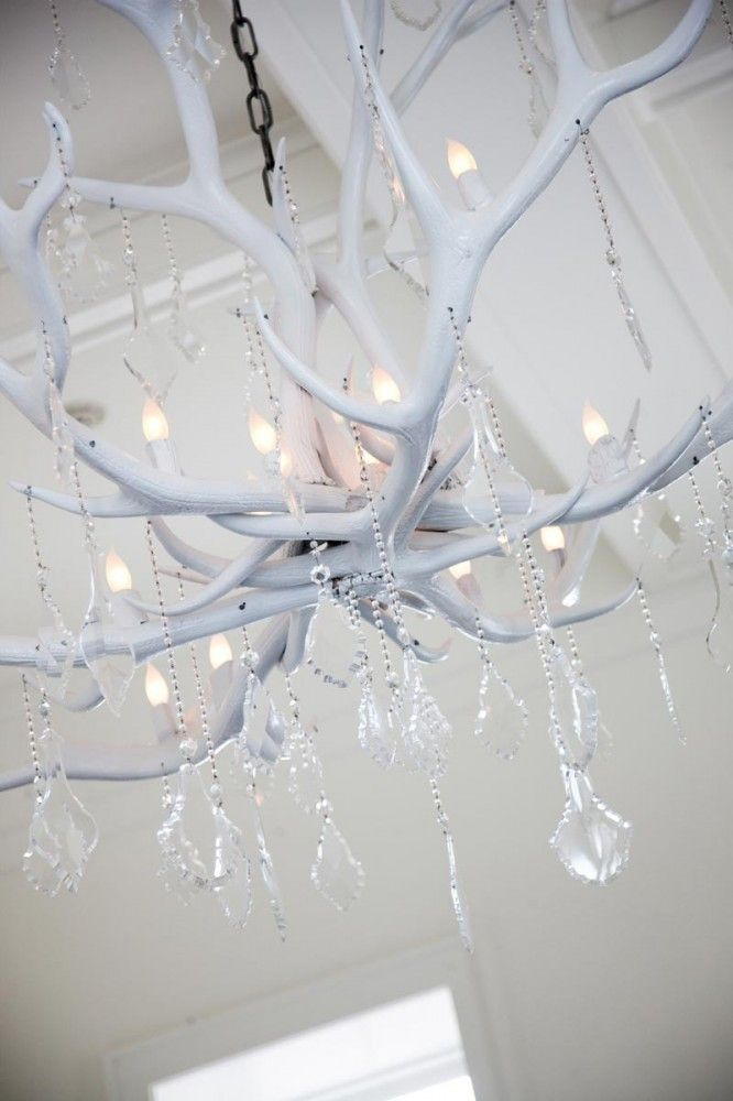 A chandelier made of antlers WITH crystals?! OMG, this is so perfect I