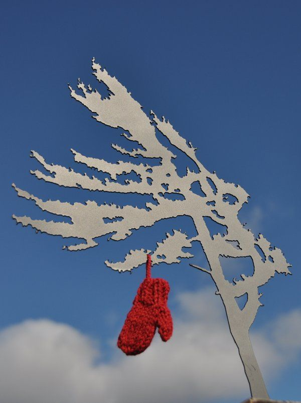 At merrymittens.com you can buy mittens to decorate any tree...jack pine or otherwise.
