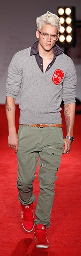 Michael Bastian ss12 - popped collar unbuttoned dark tattersall sportshirt, light grey knit v-neck sweater, skinny brown leather belt, olive cargo pant, red high-top sneakers