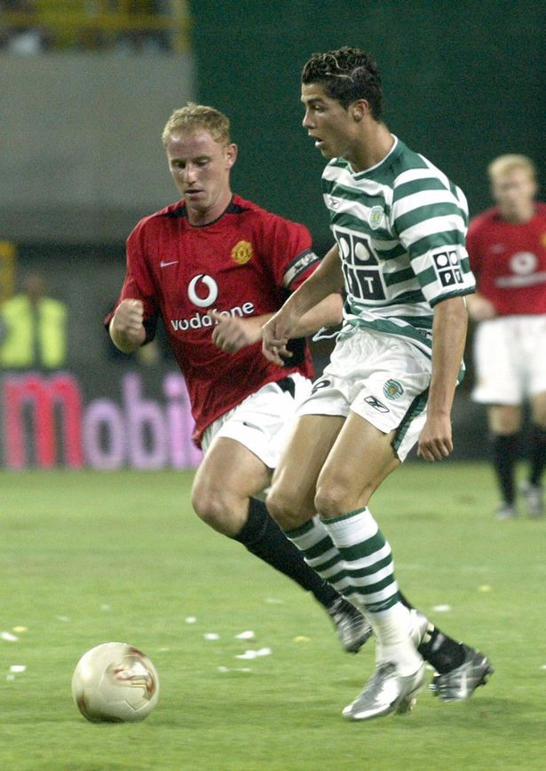 Sporting CP's Cristiano Ronaldo v Man Utd's Nicky Butt - with Scholes in the background, hands on hips.