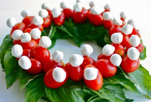 Caprese wreath. I'm thinking cherry tomatoes, cheese sticks, and basil leaves with toothpicks!