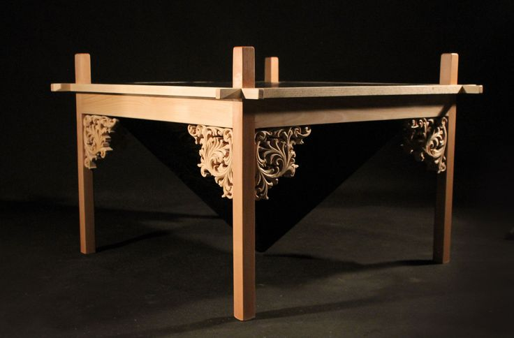 Coffee table made from oak and beech. The structure is made without using the finger screws or nails.Deck finished in technology shou sugi ban.All covered with natural oil.Hand-carved decorative motif. www.drewnoikamien.pl