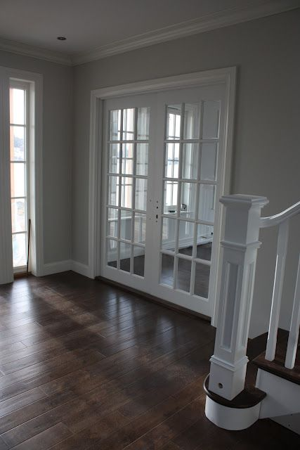 I love contrast. The dark floors with the light grey walls and white trim: