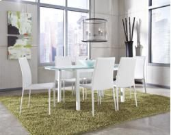 Lindys Furniture Baraga Rectangular Extension Table W 6 White Upholstered Side Chairs Add A Refreshing Metro Modern Feel To Your Dining Room