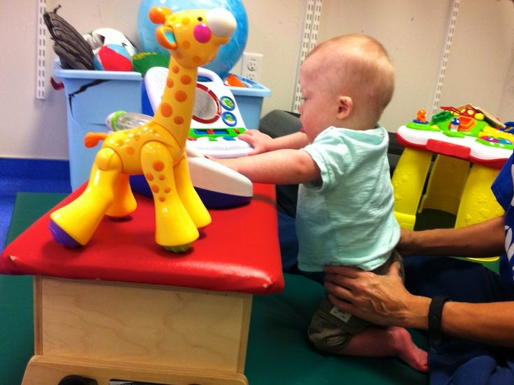 physical thearpy down syndrome baby kneeling