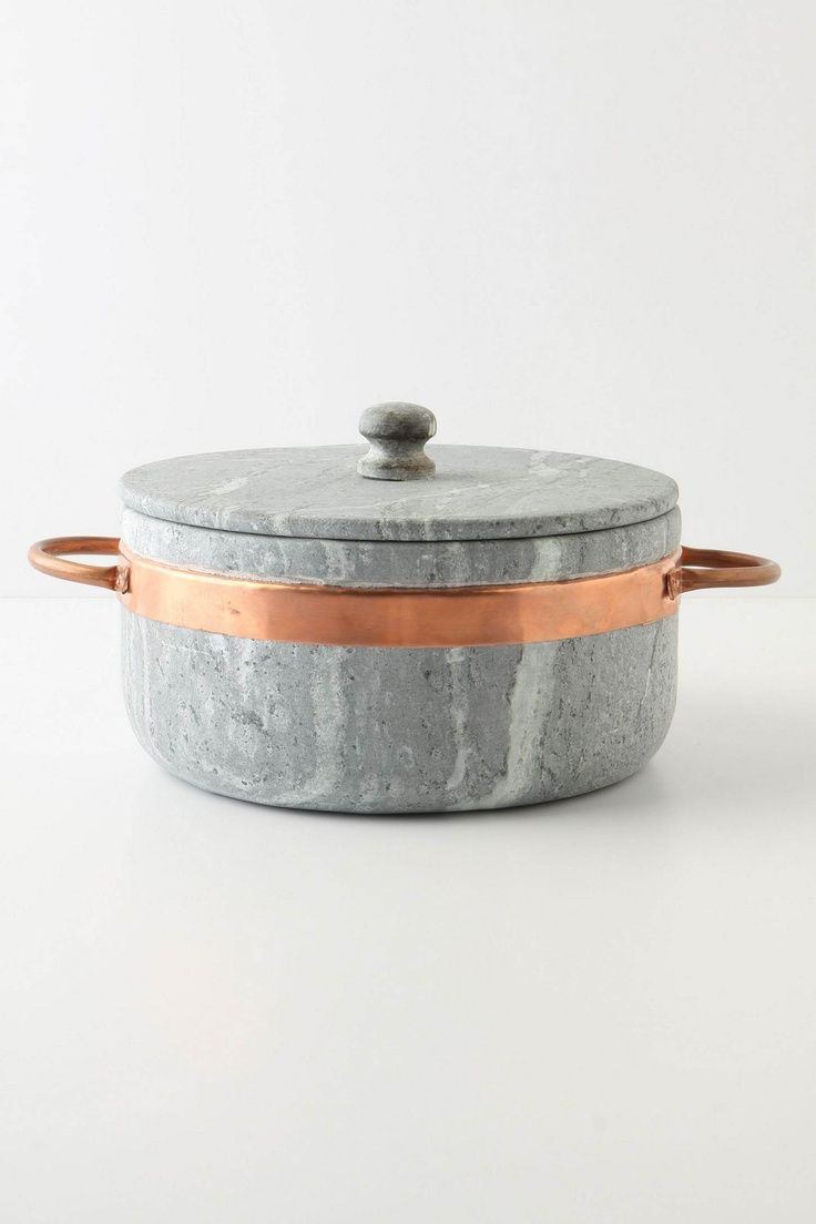 Gorgeous stone pot with Copper detail.