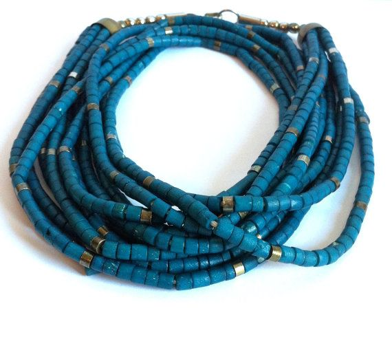"""Vintage Teal Blue Layered Necklace 1980's by ClearWaterDesignsbyK, $15.67 Https://clearwaterdesignsbyk.etsy.com Https://clearwaterdesigns.info This Vintage Teal Blue Layered Necklace has a Bohemian Flare to it. This necklace is a gorgeous Teal Blue that was popular in the early 80's & has made a return in the last couple of years.  Be Fashion Forward for Less!  This Blue & Bronze Multi Layered Necklace was made in the early 1980's. This necklace is light weight & """"swishes"""" while you walk."""