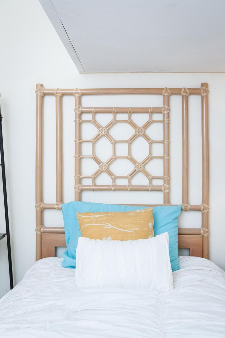As seen on Beach Flip, decorations include a bamboo headboard in the second floor guest bedroom at the renovated Coastal Calm condo.