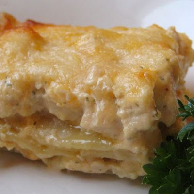 Cheesy Chicken Lasagna  2 (12 oz) cans evaporated milk (not fat-free) 1 (1 oz) pkg. dry Ranch dressing mix 3 C. cubed, cooked, chicken 1/8 tsp pepper 1 (16oz) lasagna noodles, cooked (I recommend reducing it to 8 oz to 12 oz) 1 1/2 to 2 C cheddar cheese, grated 1 1/2 to 2 C mozzarella cheese, grated  Cook the chicken and noodles first at the same time...