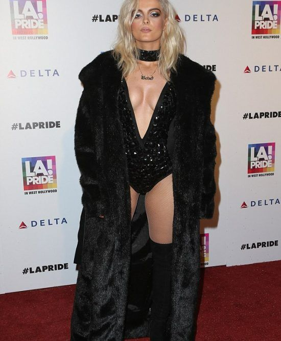 Bebe Rexha in a lavish fur coat #hollywood #singer #fashion #redcarpet #LA #fashion #fur #black #coat #luxury #minkfur #sexy #swimsuit #choker #boots