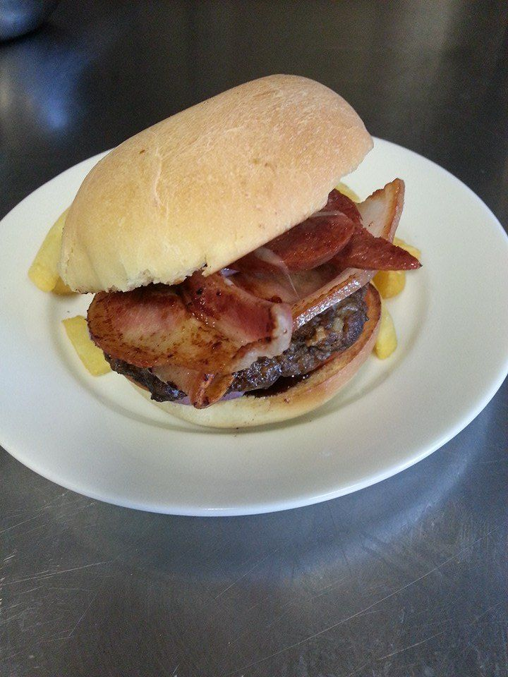 Meatlovers Burger - homemade beef pattie, chorizo, bacon, smoky bbq sauce, tomato, red onion and cheese.