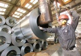 Steel News Digest - mill operator handling a steel coil