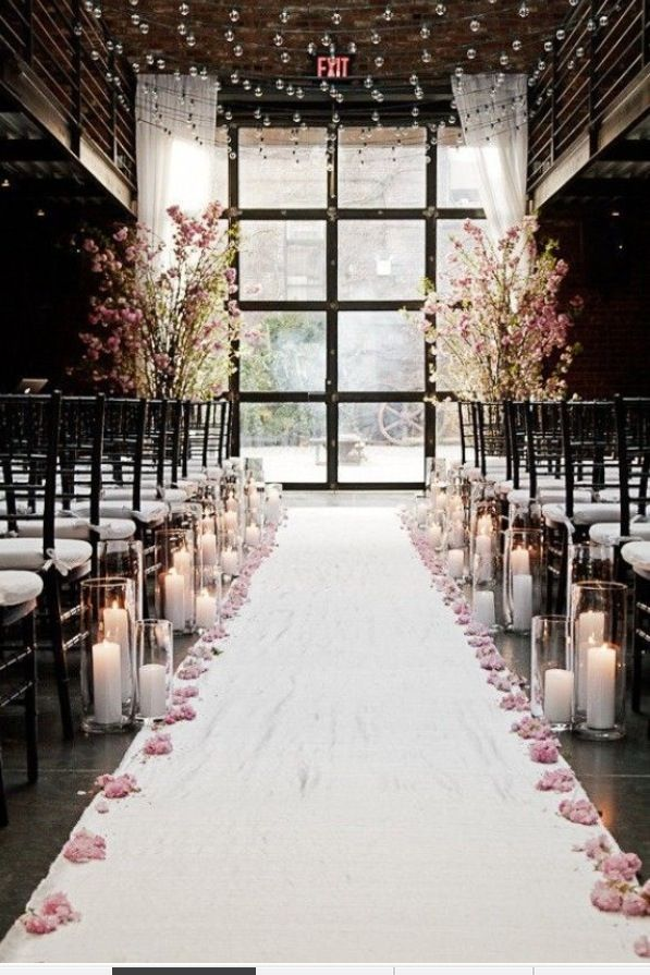 Need inspiration to decorate the path to the altar at your wedding ceremony ? Aisle decoration is a MUST! Luminara  candles are allowed in all wedding venues as the are flameless and 100% safe !