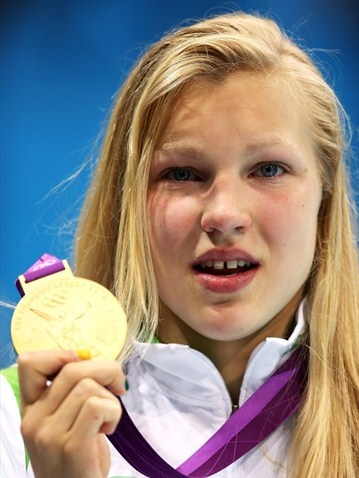 Ruta Meilutyte of Lithuania with her gold medal for the women's 100m breaststroke -Day 3 at London 2012 Olympic