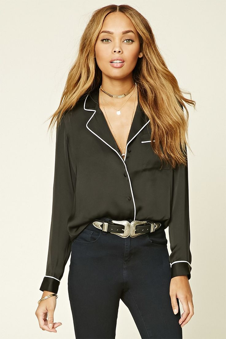 A satin pajama-inspired shirt featuring a contrast trim, notched collars, a chest pocket, button front, long sleeves, and a slightly curved hem.