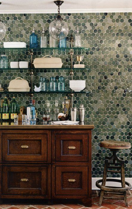 Why have a backsplash when you can have a full wall of tile? Here are ten kitchens where large swathes of tile have a big impact.