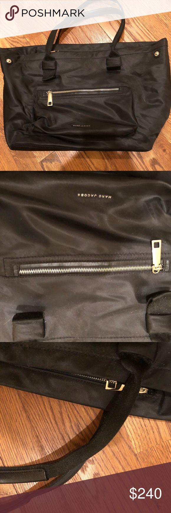 Marc Jacobs Nylon Tote bag Marc Jacobs Nylon Tote bag.  Like new condition.  Worn for a few weeks 20 x10.  Has zippers. Have original tag Marc Jacobs Bags