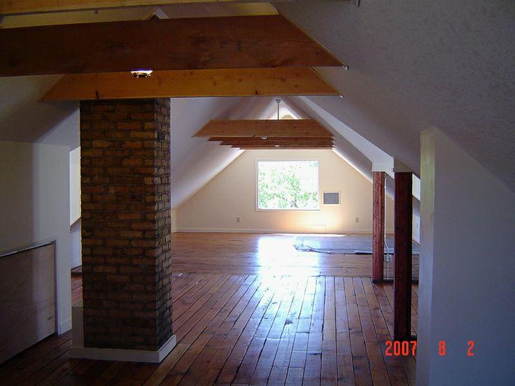 Attic renovation with exposed brick chimney