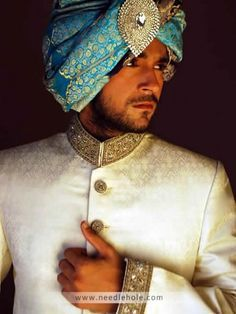 Jamawar reception sherwani for men, embellished collar, sleeves cuffs and buttons detail on front in offwhite color http://www.needlehole.com/jamawar-reception-sherwani-for-men-in-offwhite-color.html #HSY #reception #sherwani and #sherwani suits for men. Pakistani #wedding sherwani collection and indian men's sherwani suits collection by HSY men's stores in usa, uk,