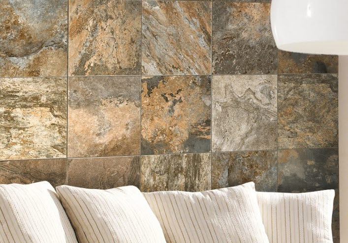 Volkan porcelain tile in Multicolor...used here on a feature wall. This slate-look mimics the rustic beauty of slate, but without the maintenance of real stone. This highly variated tile is also available in Terra, a lighter earth-tone palette.