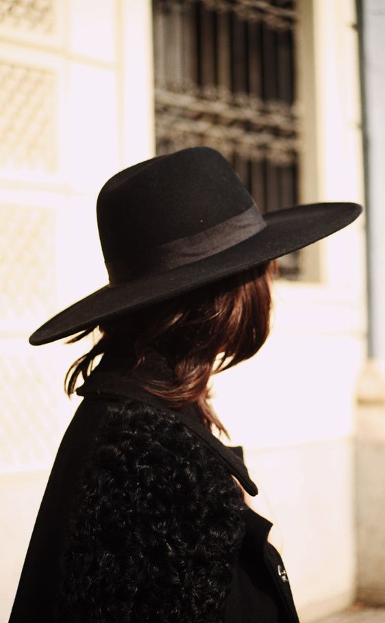 Spanish-style stiff-brimmed hat. Similar hat is worn by costumed riders on Andalusian horses in parades.