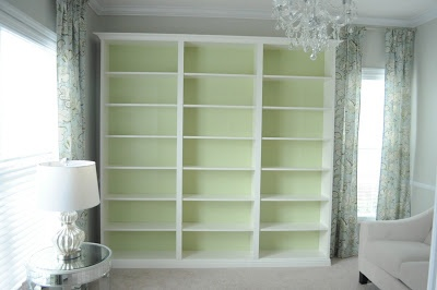 Cheap bookshelves combined into one wall unit