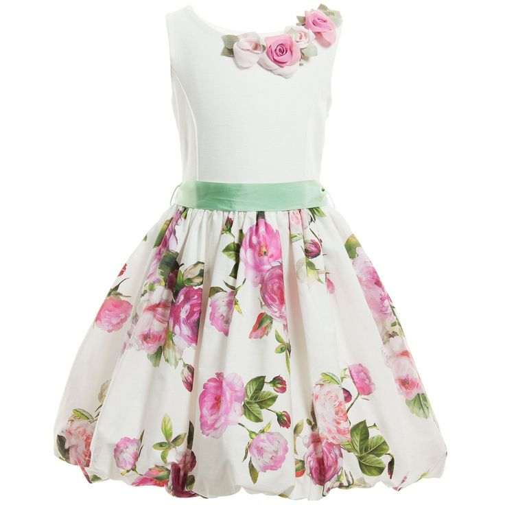 Monnalisa Chic girls sleeveless dress that has a plain ivory top half in smooth viscose jersey and a fabulous vintage rose print skirt. Made from a soft cotton, the skirt flares out at the waist and has a bubble style hem that is elasticated and fully lined, giving the style fullness and volume. The neckline is decorated with a removable rose corsage and has a removable green ribbon waist belt that ties in a bow at the back. There is a concealed side zip for easy dressing.<br ...