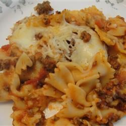bow tie pasta and beefy pasta sauce is mixed with mozzarella cheese cubes and baked in the oven to make this spooky bats and cobwebs casserole - Halloween Casserole Recipe Ideas