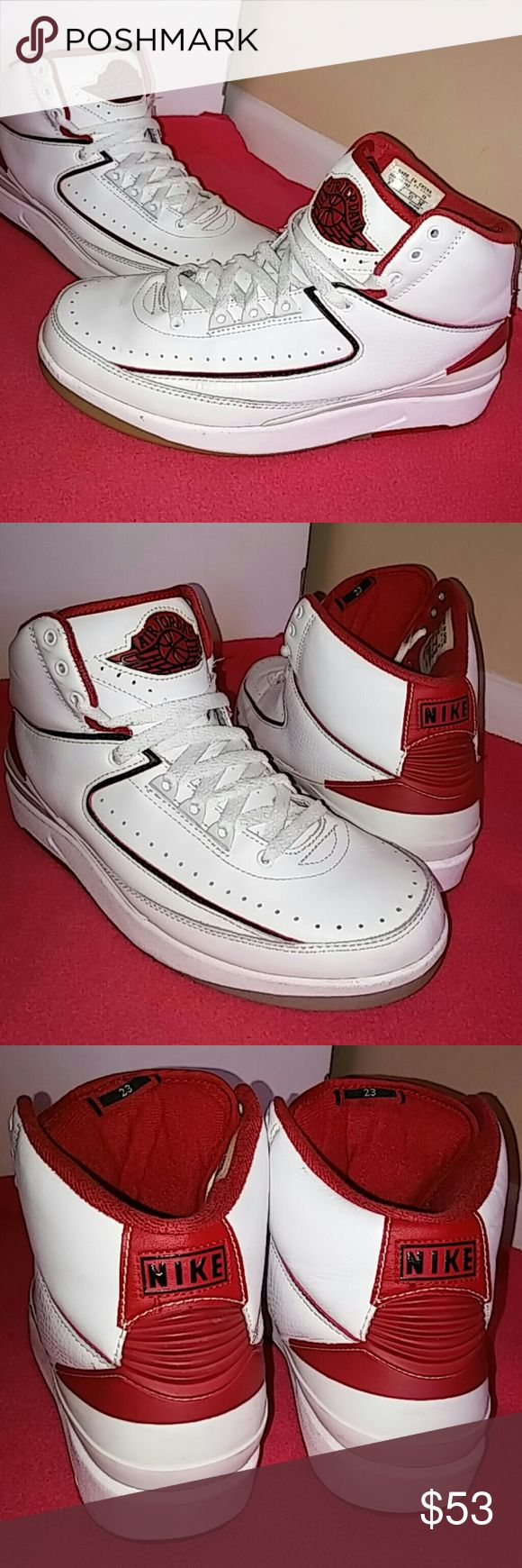 Nike Air Jordan Retro 2 Mid Top White Varsity Red. Very nice Retro 2....In awesome shape and solid in condition. Rated 8/10...Its flawless...showing minimal signs of use. Nike Shoes Sneakers