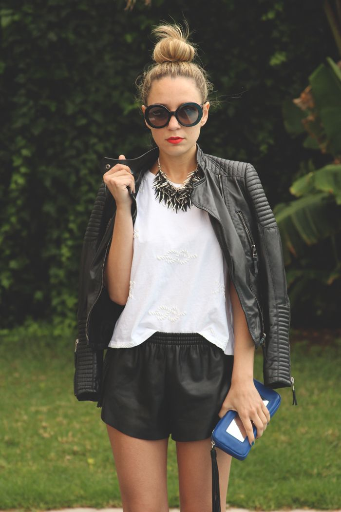 everything - leather shorts, plain T, red lip, circle glasses, heavy necklace & leather J