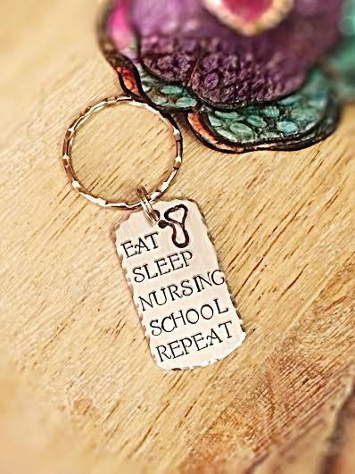 Nursing School Gifts, Gifts for Nurse, Nursing Student, Nurse Keychain, Jewelry for Nurses, Nurse Graduation, Stamped Keychain, Nurse What to get a hard working nurse to be!? This adorable hand stamped keychain! It is stamped on a 1.2 aluminum dog tag with: EAT SLEEP NURSING SCHOOL REPEAT and features a stethoscope charm. It comes on a keyring and has hammered edges. Each item purchased is handmade and stamped one letter, number, or design at a time using a hammer. Slight alignment may…