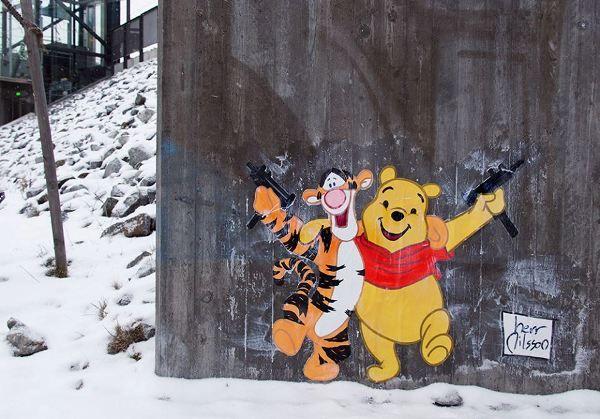 Swedish street artist Herr Nilsson portrays Disney princesses and other cartoon characters as sadistic gun and knife-toting criminals.