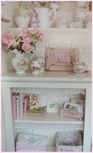 *Enchanting Decor'... Pretty pink on shelves and lace.