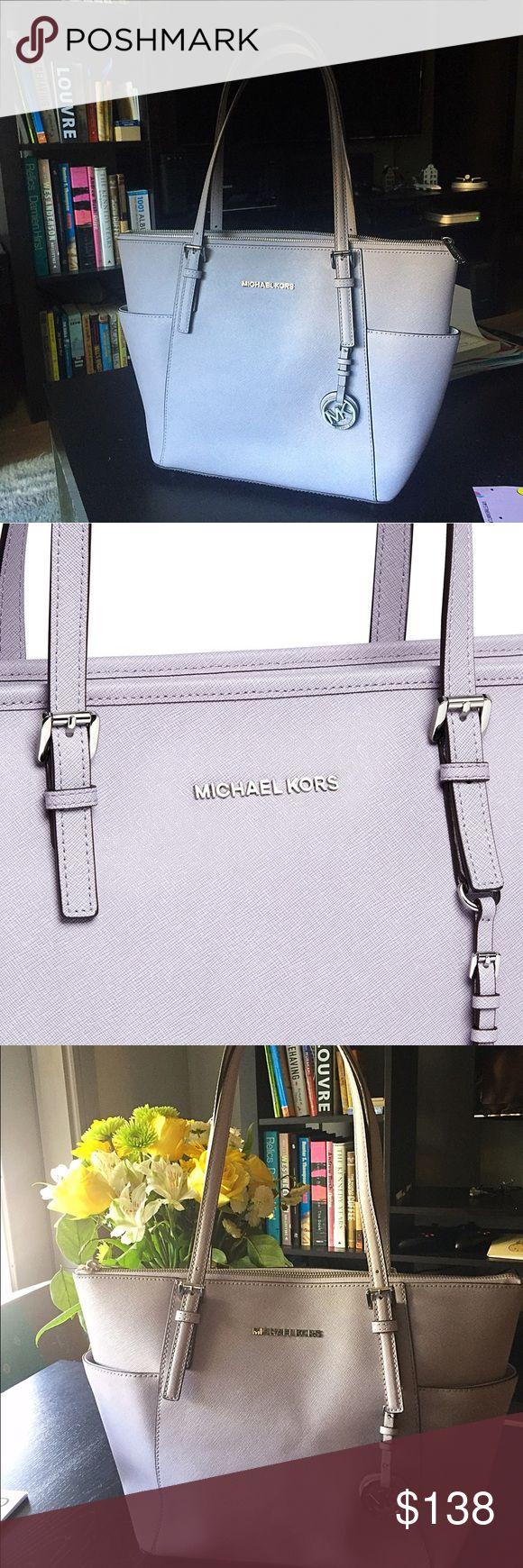 Michael Kors Saffiano Leather Lilac Tote 💜 Beautiful lilac ( light purple ) tote perfect for any season! Has lovely MK logo lining with tons of pockets for organizing. Sadly since we recently moved it somehow got small discoloration on the bottom and scratch on the clasp on the back side of the bag. (pcs attached) However as you can see from pictures those are not very visible. Got it is as a present and really hope to find a lovely new home for her 💞 firm on the price Michael Kors Bags…