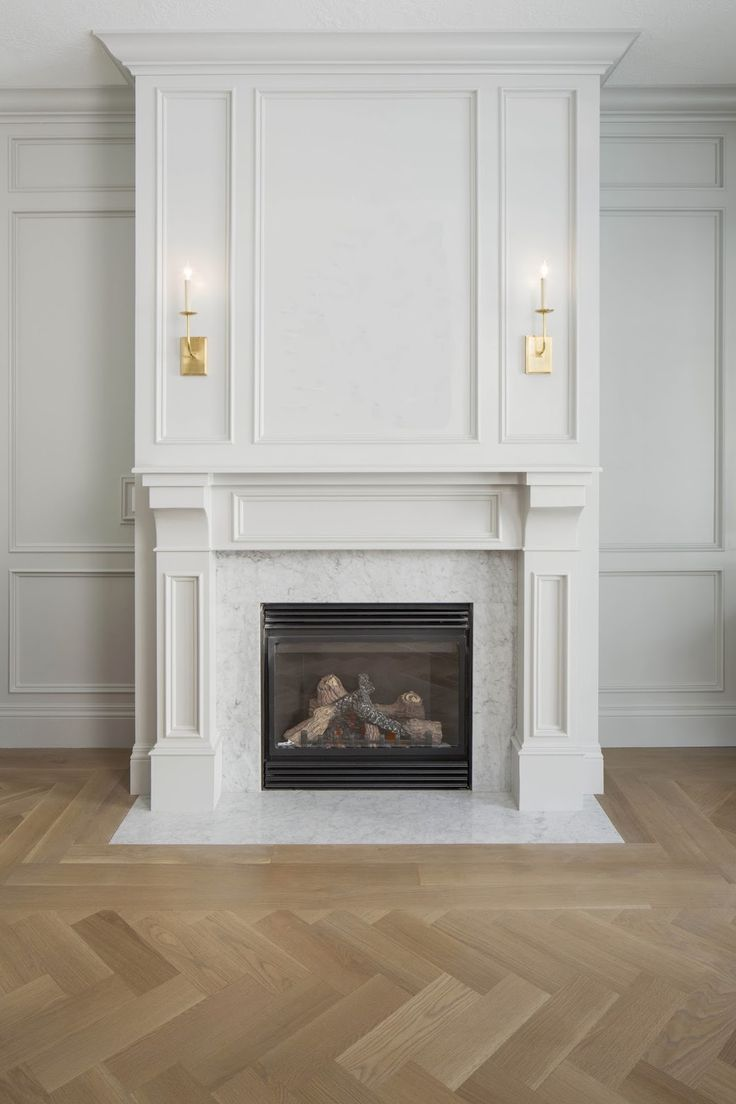 Panelling Mantle To Ceiling Visual Comfort Sconces, Gray Wainscot Room,  Herringbone Floors, Carrara Marble Fireplace Surround Via WHITE + GOLD
