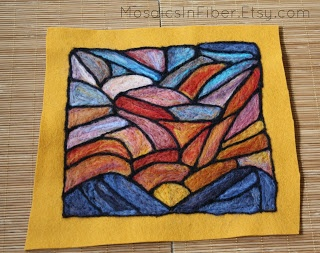 A stained glass sunset done in wool.