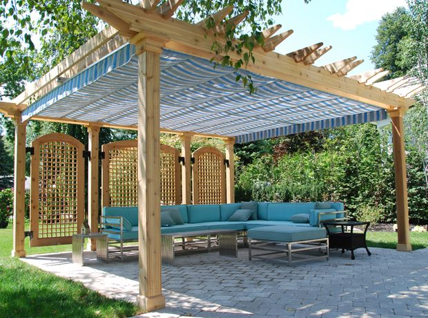 Privacy in the pergola with false lattice-work doors and a retractable canopy. Links to canopy supplier website (with more photos of canopies!!!)