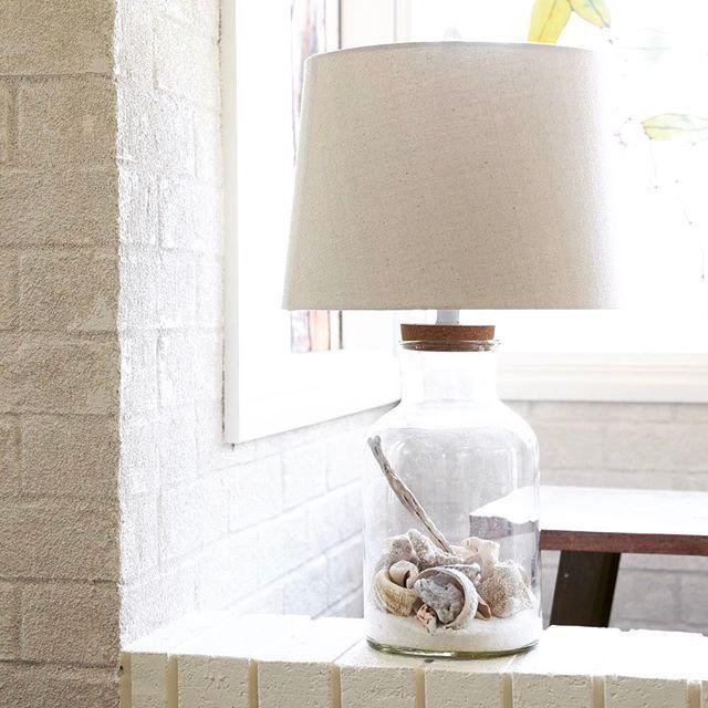 She Sells Sea Shells ..... Holiday treasures have found their home, Black Mango Jar Lamp perfect for Sea Shells & Driftwood 🏝 #beach #holiday #treasure #jar #lamp #glass #lighting #tablelamp #interiordesign #interior