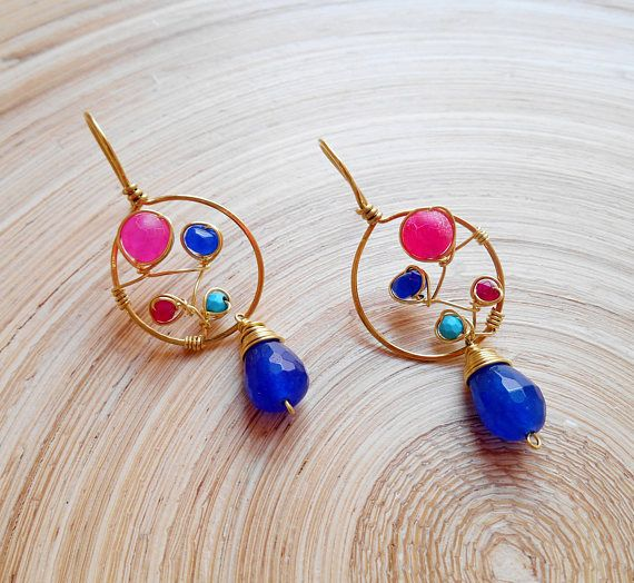 With a bold color combination of cobalt blue, fuchsia and turquoise and a modern minimal vine formation design, Leticia gemstone wire wrap earrings will lend a touch of vivacity to any look. I hand formed and hammered a round frame out of gold filled wire and inside it I lovingly
