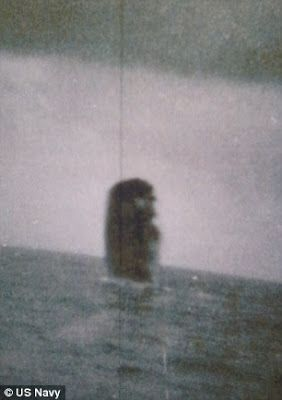 US Navy Sailors' Secret UFO Photos  A secretive set of photographs has emerged showing two unidentified objects near a US Navy submarine.  The pictures, which had been withheld from public release for years, are believed to have been taken in 1971 by sailors aboard the USS Trepang submarine during a mission near Iceland.  The grainy photographs include one of a black triangular object flying low over the water and a series of shots showing a large cigar-shaped object which appears to crash…
