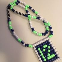 "Handmade beaded ""Flag"" style necklace perfect for showing off your 12th Man pride and love for the Seattle Seahakws!   Dark Blue, Lime Green, & Gray with ""SEATTLE SEAHWKS"" written in the chain with beads."