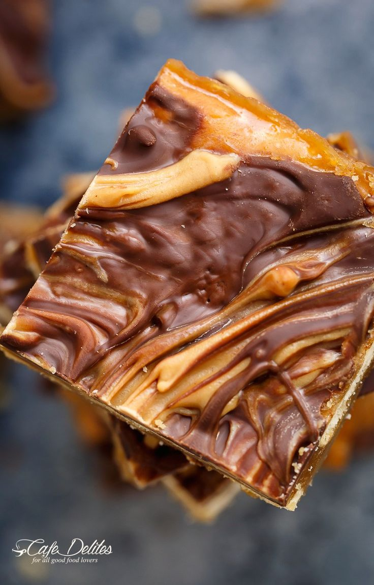 Peanut Butter Swirl Saltine Toffee (Christmas Crack) is all of your Christmas dreams come true – on crack! It's easy to make with only FIVE INGREDIENTS! | http://cafedelites.com
