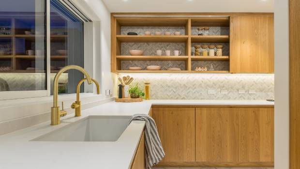 Du Bois says the owners requested an open larder for ease of access. As with the kitchen splashback, the wall features ...