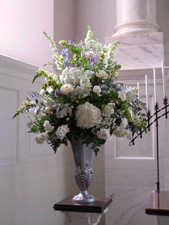 Elegant white and blue floral arrangement for Church setting...Ceremonies – Wedding Flowers Lake Jackson Texas