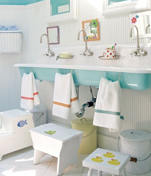 low hand towels and long farm sink. great idea for kids!- that is so cute if you have a lot of kiddos that use one bathroom!