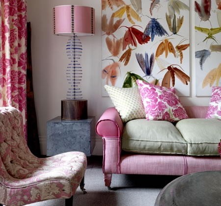 .not sure about the pink and gray couch combo but i like the huge print behind the couch and the colorful lamp and bright curtains - the idea more than the colors or specific motifs here