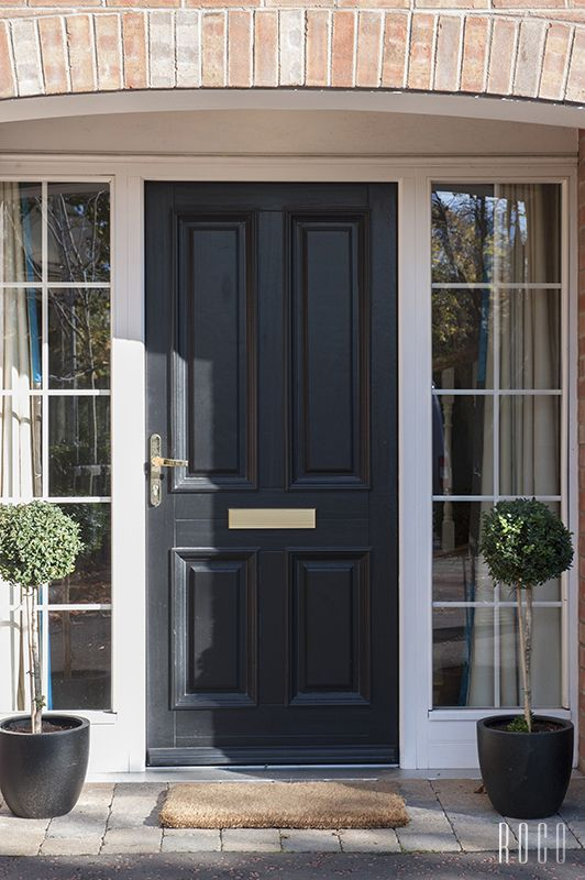 Entrance doorset with a black finish. Glazed side panels to let in as much natural light as possible. Just like a Curtis door.