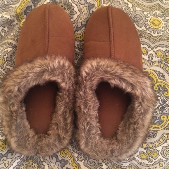 Brown comfy slippers Brown slippers with foam inside to keep feet from hurting they have fur on the outside and can be worn outside as well Shoes Slippers