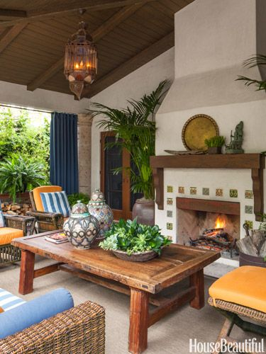 David Dalton created a relaxing year-round space with insulated Sunbrella curtains and a fireplace decorated with custom Talavera tiles by Mission Tile West.