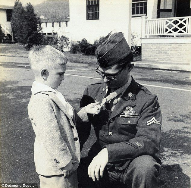 My hero father: Desmond Doss Jr holds his father's Medal of Honor. The Seventh…